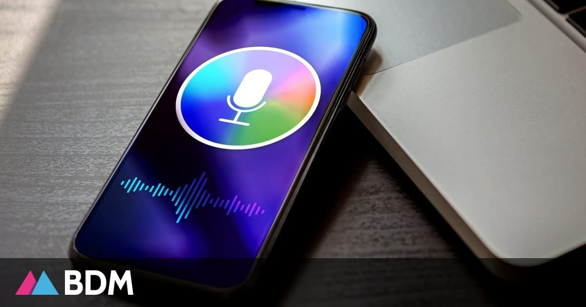 Personal voice assistant siri concept, deep learning sound recognition application on mobile phone screen. Close-up smartphone with microphone icon and wave sound symbol
